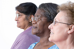 Multiracial group of older women in profile,