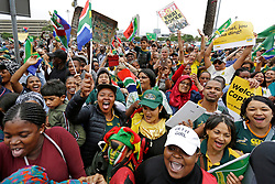 Monday 11th November 2019.<br /> City Hall, Grand Parade,<br /> And City Centre, Cape Town,<br /> Western Cape,<br /> South Africa.<br /> <br /> SPRINGBOKS CELEBRATE WINNING THE RUGBY WORLD CUP CHAMPIONSHIP IN 2019 WITH A COUNTRYWIDE VICTORY TOUR!<br /> <br /> SPRINGBOKS RUGBY WORLD CUP VICTORY TOUR CAPE TOWN!<br /> <br /> Thousands of excited fans wait on Cape Town's Grand Parade for the Springboks to arrive.<br /> <br /> The reigning Rugby World Cup Champions namely the South African Springbok Rugby Team, celebrates winning the Webb Ellis Cup during the International Rugby Football Board Rugby World Cup Championship held in Japan in 2019 with their Victory Tour that culminated in the final city tour taking place in Cape Town. Thousands of South African fans filled the streets of the city all trying their best to show their support for their beloved Springboks and to celebrate them winning the Rugby World Cup for the third time. South Africa previously won the Rugby World Cup in 1995, 2007 and now again in 2019. South African Springbok Captan Siya Kolisi took the opportunity to speak to the gathered crowd about how something like this brings unity and that we should live together as a nation that practices what is known as ubuntu. Ubuntu is a quality that includes the essential human virtues of compassion and humanity. This image taken in Cape Town on Monday 11th November 2019.<br /> <br /> This image is the property of Seven Bang Media Group (Pty) Ltd, hereinafter referred to as SBM.<br /> <br /> Picture By: SBM / Mark Wessels. (11/11/2019).<br /> +27 (0)61 547 2729<br /> mark@sevenbang.com<br /> www.sevnbang.com<br /> <br /> Copyright © SBM. All Rights Reserved.