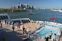 Early boarders on the May 2013 voyage to Southampton, UK, get a panoramic view of New York, USA, from the stern of the Queen Mary 2. 201305042352<br /> <br /> Copyright Image from Victor Patterson, 54 Dorchester Park, Belfast, UK, BT9 6RJ<br /> <br /> Tel: +44 28 9066 1296<br /> Mob: +44 7802 353836<br /> Voicemail +44 20 8816 7153<br /> Skype: victorpattersonbelfast<br /> Email: victorpatterson@me.com<br /> Email: victorpatterson@ireland.com (back-up)<br /> <br /> IMPORTANT: If you wish to use this image or any other of my images please go to www.victorpatterson.com and click on the Terms & Conditions. Then contact me by email or phone with the reference number(s) of the image(s) concerned.