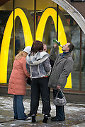 Moscow, Russia, 20/02/2005..Russians drinking beer outside a McDonalds restaurant by the entrance to Red Square.