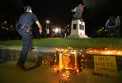 August 13, 2017 - Atlanta, Georgia, U.S. - Atlanta Police move into Piedmont Park to prevent protesters during a anti white nationalism memorial and march in response to violence in Virginia from toppling a Confederate monument with a chain after they spray painted it on Sunday. The peace monument at the 14th Street entrance depicts a angel of peace stilling the hand of a Confederate soldier about to fire his rifle. (Credit Image: © Curtis Compton/TNS via ZUMA Wire)