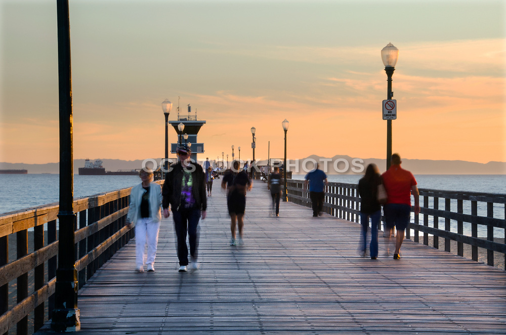 People Walking on the Seal Beach Pier