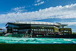 July 3, 2018 - London, U.S. - LONDON, ENGLAND - JULY 03: morning crew prepare courts for day two match of Wimbledon on July 3, 2018, at All England Lawn Tennis and Croquet Club in London, England. (Photo by Chaz Niell/Icon Sportswire) (Credit Image: © Chaz Niell/Icon SMI via ZUMA Press)