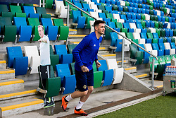 Northern Ireland striker Kyle Lafferty places a cardboard cutout in the dugout of Northern Ireland manager Michael O'Neill during the training session at Windsor Park, Belfast. PRESS ASSOCIATION Photo. Picture date: Friday September 7, 2018. See PA story SOCCER N Ireland. Photo credit should read: Liam McBurney/PA Wire