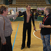 "World Champion same-sex ballroom dancer Robert Tristan Szelei, center, greets his mother, left, and brother at the end of the 2nd annual World Championship Same-Sex Ballroom Dancing competition, held in their hometown, Budapest, Hungary, on October 21, 2006. ..Szelei and his dancing partner, Gergely Darabos, who are known as the ""Black Swans,"" are the reigning world champions in men?s Latin same-sex ballroom dancing. They have been training and preparing to host the 2nd annual World Championship and the Csardas Cup, the first-ever Eastern European same-sex ballroom competition, both held at the Korcsarnok arena.  This is the pinnacle event of the blossoming same-sex ballroom scene...Szelei and Darabos went on to win the men?s Standard division and finished fourth in the Latin division. ..The event was organized by the US-based World Federation of Same-Sex Dancing, which hosted the first World Championship Same-Sex championships in 2005 in Sacramento, California. The Black Swans did a large amount of the coordination and planning in Budapest, a city that had never seen an event of this kind. When government funding fell through, they secured funding from patron Desire (accent on the ?e?) Dubounet, owner of the local Club Bohemian Alibi drag club. ..The World Championship events are newly recognized, but same-sex dancers have been competing on a national and international circuit for a number of years, especially in Europe, including at the Eurogames, the Gay Games, the London Pink Jukebox Trophy and the Berlin Open, among others. Countries including the United States, the Netherlands, Germany and, now, Hungary, hold their own national same-sex championships. Hungary held its first national championships in April 2006...Szelei and Darabos spent three months at the Sacramento Dancesport same-sex dance school in California this summer, on the first scholarship offered by the World Federation. The men both got their early training as opposite sex dancers, then started da"