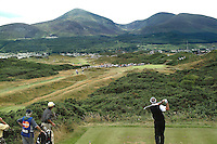 Bob Charles, professional golfer, New Zealand, plays a tee shot at the 4th. Panoramic view. Mountains of Mourne, in the distance. Taken at British Seniors Open Championship at Royal County Down, Newcastle, N Ireland. Ref: 200107293040.<br /> <br /> Copyright Image from Victor Patterson, Belfast, UK<br /> <br /> t: +44 28 9066 1296 (from Rep of Ireland 048 9066 1296)<br /> m: +44 7802 353836<br /> e: victorpattersonbelfast@gmail.com<br /> <br /> www.images4media.com<br /> <br /> Please see my full Terms and Conditions of Use at https://www.images4media.com/p/terms-conditions - it is IMPORTANT that you familiarise yourself with them.<br /> <br /> Images used online incur an additional cost. This cost should be agreed in writing in advance. Online images must be visibly watermarked i.e. © Victor Patterson or that of the named photographer within the body of the image. The original metadata must not be deleted from images used online.<br /> <br /> This image is only available for the use of the download recipient i.e. television station, newspaper, magazine, book publisher, etc, and must not be passed on to a third party. It is also downloaded on condition that each and every usage is notified within 7 days to victorpattersonbelfast@gmail.com.<br /> <br /> The right of Victor Patterson (or the named photographer) to be identified as the author is asserted in accordance with The Copyright Designs And Patents Act (1988). All moral rights are asserted.