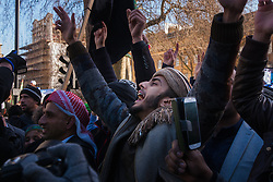 London, February 8th 2015. Muslims demonstrate outside Downing Street  to denounce the uncivilised expressionists reprinting of the cartoon image of the Holy Prophet Muhammad. PICTURED: Youths chant slogans as Britain First counter-protesters hurl abuse.