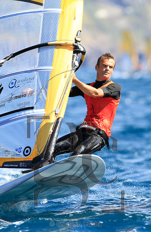 Portugal, Funchal, Madeira :  Portuguese João Rodrigues, competes on February 24, in 2012 European Windsurfing Championships in the bay of Funchal on the Portuguese archipelago of Madeira.Photo Gregorio Cunha .Campeonato da Europa de windsuf, classe RSX, na baia da cidade do Funchal,  Iha da Madeira, Portugal..Foto Gregorio Cunha