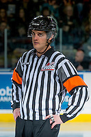 KELOWNA, CANADA - DECEMBER 27: Referee Steve Papp stands at centre ice between the Kelowna Rockets and the Kamloops Blazers on December 27, 2016 at Prospera Place in Kelowna, British Columbia, Canada.  (Photo by Marissa Baecker/Shoot the Breeze)  *** Local Caption ***