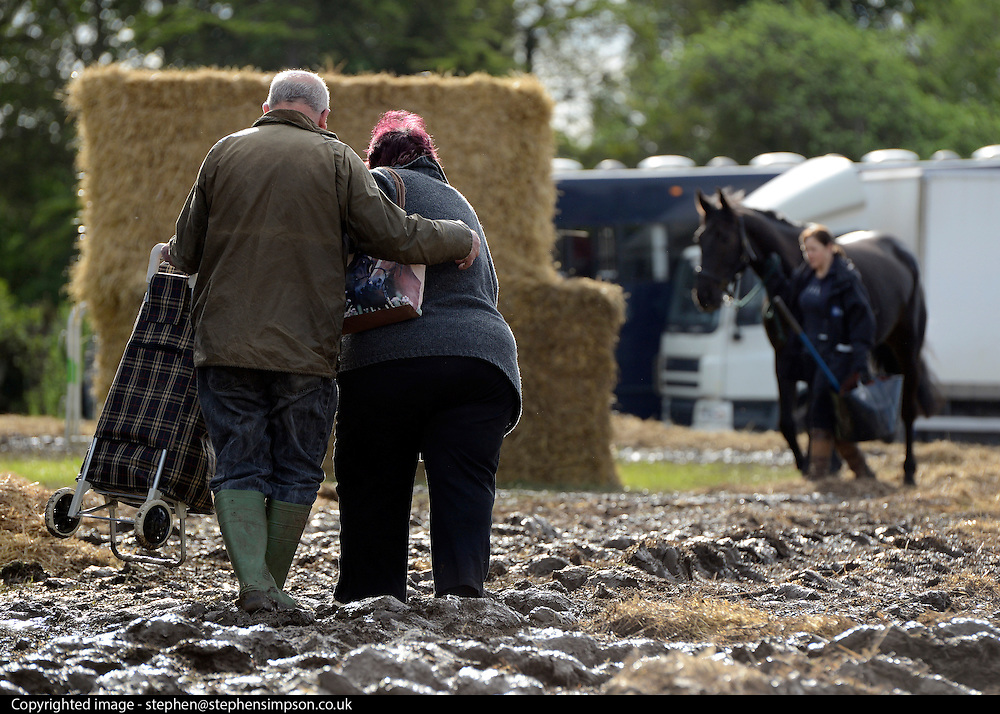 © Licensed to London News Pictures. 11/05/2012. Windsor, UK People struggle through the mud. The public car parks for the show have been closed until the weekend. The Royal Windsor Horse Show in Windsor, England on May 11 2012. Photo credit : Stephen Simpson/LNP