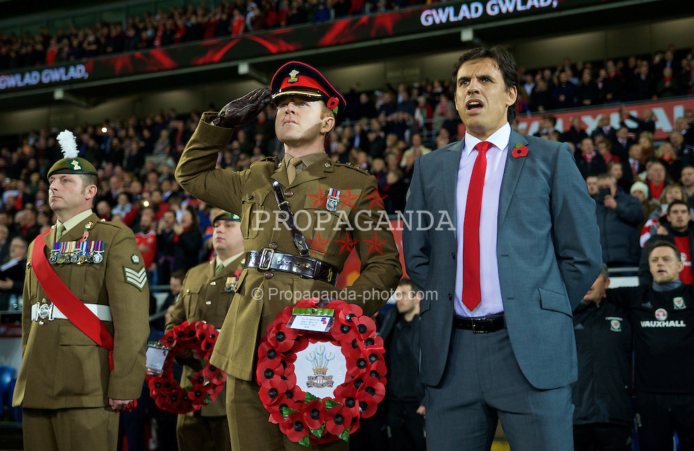 CARDIFF, WALES - Saturday, November 12, 2016: Wales' manager Chris Coleman stands with military personnel before the 2018 FIFA World Cup Qualifying Group D match against Serbia at the Cardiff City Stadium. (Pic by David Rawcliffe/Propaganda)