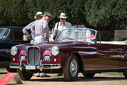 © Licensed to London News Pictures. 02/09/2017. London, UK. Visitors to the Concours of Elegance show admire a 1958 Alvis Graber Convertible on display in the grounds of Hampton Court Palace. The Concours of Elegance brings together, over three days, a selection of 60 of the rarest cars from around the world some of which have never been seen before in the UK. Each car owner is asked to vote on the other models on display to decide which car is considered to be the 'Best of Show'. The show also displays of hundreds of other fine motor cars, including entrants to The Club Trophy. Photo credit: Peter Macdiarmid/LNP