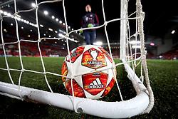 An adidas official match ball in a goal net during warm-up