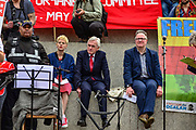 Shadow Chancellor John McDonnell on stage in Trafalgar Square as they take part in the Labour Day March on 1st May, 2019 in London,England, United Kingdom.The march coincides with International Workers Day and campaigns for trade union rights,  workers<br /> protection and for 1st May to be a public holiday.