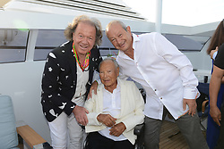L-R : Egyptian billionaire Naguib Sawiris (right) poses with his father Onsi (center) on his private yacht in Cannes, France on May 21, 2017. Sawiris organized a party on his yacht to announce the launch of a new film festival to take place in Egypt in September 2017 at El Gouna small town. Photo by Ammar Abd Rabbo/ABACAPRESS.COM