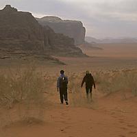 Hikers descend the Wadi Um Ishrin in the Wadi Rum region of Jordan.