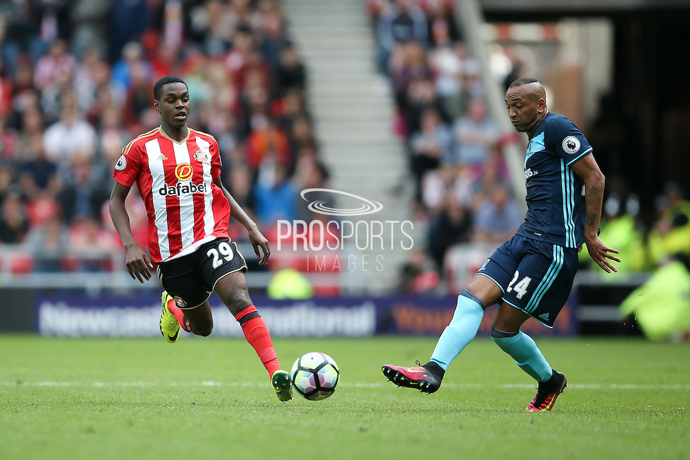 Sunderland forward Joel Asoro (29) chases down Middlesbrough midfielder Emilio Nsue (24)  during the Premier League match between Sunderland and Middlesbrough at the Stadium Of Light, Sunderland, England on 21 August 2016. Photo by Simon Davies.