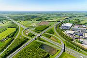 Nederland, Utrecht, gemeente Vijfheerenlanden , 13-05-2019; Knooppunt Everdingen, kruising van de rijkswegen A2 (links boven, rechts onder) en A27, gedeeltelijk turbineknooppunt. Bedrijventerreinen Vianen, De Biezen.<br /> Everdingen junction south of Utrecht.<br /> <br /> luchtfoto (toeslag op standard tarieven);<br /> aerial photo (additional fee required);<br /> copyright foto/photo Siebe Swart