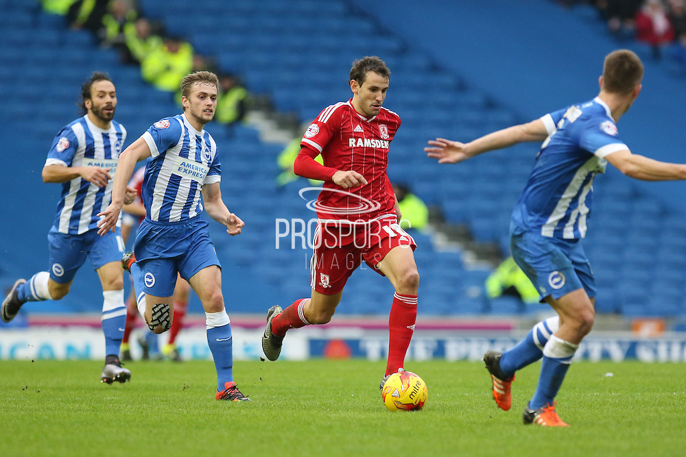 Middlesbrough FC striker Christian Stuani beats off Brighton striker (on loan from Manchester United), James Wilson (21) during the Sky Bet Championship match between Brighton and Hove Albion and Middlesbrough at the American Express Community Stadium, Brighton and Hove, England on 19 December 2015. Photo by Phil Duncan.