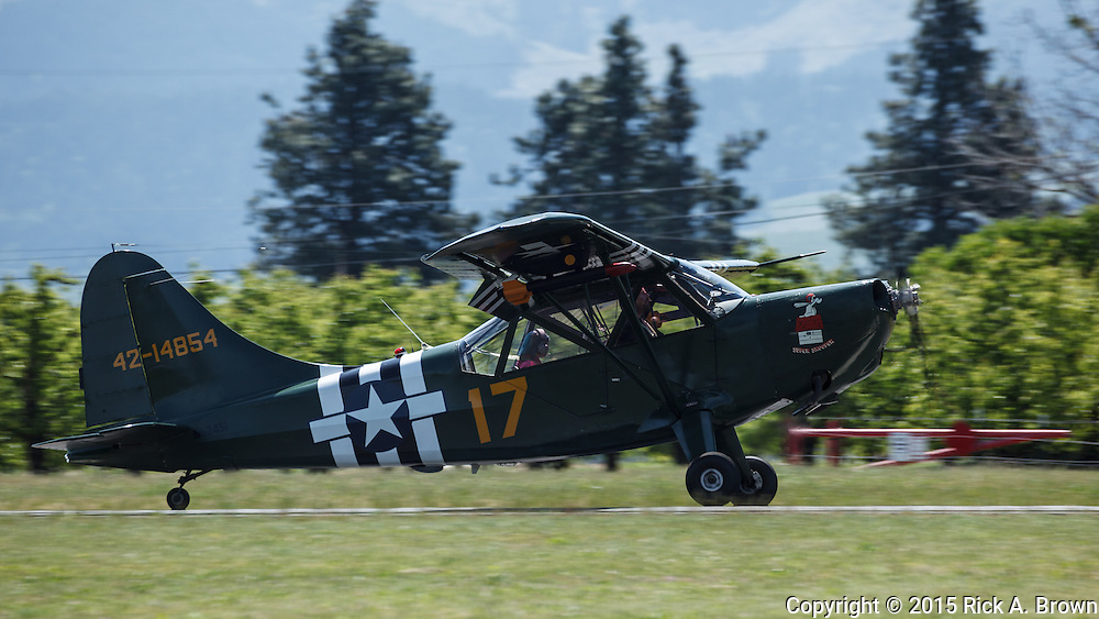 Stinson L-5 Sentinel taking off  at WAAAM.