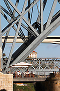 Dom Luis I bridge seen from Cais da Ribeira restaurant terrace porto portugal