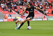 Portsmouth FC defender Matthew Clarke (5) sand Doncaster Rovers forward Alfie May (19) during the EFL Sky Bet League 1 match between Doncaster Rovers and Portsmouth at the Keepmoat Stadium, Doncaster, England on 25 August 2018.Photo by Ian Lyall.