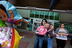 Conjoined twins Tatiana and Krista Hogan get balloons after enduring multiple doctor's visits, Vancouver, British Columbia, Canada, March 4, 2011. Born Oct. 25, 2006 to parents Felicia Simms and Brendan Hogan, neurologists say the twins are the only such set that have a common neurological connection.