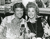 1978 Radio commentator/interviewer, Gregg Hunter is seen interviewing Charlotte Ray during his KIEV radio show at the Hollywood Brown Derby Restaurant, on Vine St.