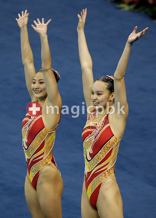 Silver medalist Xuechen Huang and Ou Liu of China react after competing in the Synchronized (synchronised) Swimming Technical Duets Final round during the 14th FINA World Aquatics Championships at the Oriental Sports Center in Shanghai, China, Monday, July 18, 2011. (Photo by Patrick B. Kraemer / MAGICPBK)