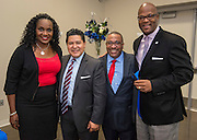 Houston ISD trustee Wanda Adams, superintendent Richard Carranza, Steve Gourrier and Dwight Boykins pose for a photograph following a ribbon cutting ceremony at South Early College High School, October 8, 2016.