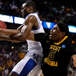 Mar 19, 2011; Tampa, FL, USA; West Virginia Mountaineers forward Kevin Jones (5) fouls Kentucky Wildcats guard Darius Miller (1) while battling for a rebound during the first half of the third round of the 2011 NCAA men's basketball tournament at the St. Pete Times Forum.  Mandatory Credit: Derick E. Hingle