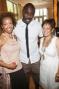 24 June 2010- Miami Beach, Florida- I to r: Andrea Ware, Idris Elba and Dolly Turner at the The 2010 American Black Film Festival Founder's Brunch held at Emeril's on June 24, 2010. Photo Credit: Terrence Jennings/Sipa