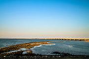 Nederland, Zeeland, Gemeente Veere, 17-03-2016;   Oosterscheldekering (stormvloedkering Oosterschelde) vanaf het eiland Neeltje Jans, gezien naar Roggenplaat met sluitgat Schaar in de voorgrond. Sluitgat Schaar en Schouwen-Duiveland in het verschiet.<br /> <br /> copyright foto/photo Siebe Swart