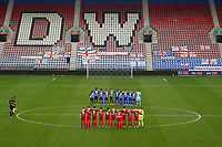 Football - 2020 / 2021 FA Cup - Round One - Wigan Athletic vs Chorley - DW Stadium<br /> <br /> Wigan Athletic and Chorley FC players pay their respects during a minute silence ahead of kick-off<br /> <br /> COLORSPORT/PAUL GREENWOOD