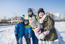Portrait of children on snow field