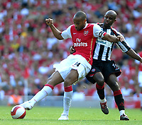 Photo: Ed Godden.<br />Arsenal v Sheffield United. The Barclays Premiership. 23/09/2006. Arsenal's Thierry Henry (L) is challenged from behind by David Sommeil.