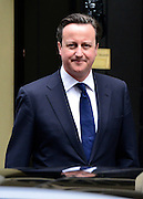 © Licensed to London News Pictures. 10/04/2013. Westminster, UK David Cameron British Prime Minister leaves Downing Street today for a special session of recalled parliament to discuss the recent death of Margaret Thatcher . Photo credit : Stephen Simpson/LNP