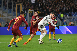 November 27, 2018 - Rome, Italy - AS Roma Turkish forward Cengiz Under (L) and Bryan Cristante vie Gareth Bale of Real Madrid  during the Champions league football match between AS Roma  and Real Madrid at Olimpico stadium in Rome, Italy, on November 27, 2018. (Credit Image: © Federica Roselli/NurPhoto via ZUMA Press)