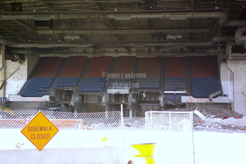 """Razing the New Haven Coliseum. Deconstruction Project as seen on 13 April 2006 from Crown Street. North West Elevation showing under garage steel detail, HVAC, seating, support piers, venue ceiling and the parking garage above. The Garage was eventually """"Imploded"""" to ground level for removal."""