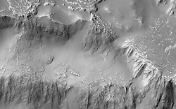 Jun 28, 2017 - Mars Orbit - Various researchers are often pre-occupied with the quest for flowing water on Mars. However, this image from NASA's Mars Reconnaissance Orbiter (MRO), shows one of the many examples from Mars where lava (when it was molten) behaved in a similar fashion to liquid water. This image covers the three falls in the north-central region of the crater wall. The lava flows and falls are distinct as they are rougher than the original features that are smooth and knobby. In a close-up image the rough-textured lava flow to the north has breached the crater wall at a narrow point, where it then cascades downwards, fanning out and draping the steeper slopes of the wall in the process. (Credit Image: © JPL-Caltech/NASA via ZUMA Wire/ZUMAPRESS.com)