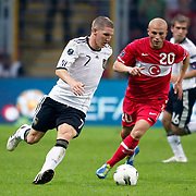 Turkey's Gokhan TORE (R) and Germany's Bastian SCHWEINSTEIGER (L) during their UEFA EURO 2012 Qualifying round Group A matchday 19 soccer match Turkey betwen Germany at TT Arena in Istanbul October 7, 2011. Photo by TURKPIX