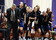Amherst College head coach GP Gromacki, left, and his team react during a game against Williams, Saturday, Jan. 10, 2015, in Amherst, Mass. Amherst has broken UConn's women's NCAA record with 104 consecutive home victories and is closing in on the Kentucky men's record of 120-plus wins set decades ago. (Jessica Hill for the New York Times)