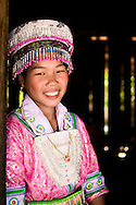 Laos, Muang Sing. Hmong girl wearing beautiful dress because of the Hmong New Year's festival.