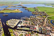 Nederland, Friesland, Gemeente Boornsterhem /  De Friese Meren., 01-05-2013; Terhorne (Terherne), dorp ten oosten van Sneekermeer. Links van de atletiekbaan Kameleondorp, naar de kinderboeken serie Kameleon.<br /> Holiday camp near the lakes in the north of the Netherlands. <br /> luchtfoto (toeslag op standard tarieven)<br /> aerial photo (additional fee required)<br /> copyright foto/photo Siebe Swart
