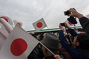 Well-wishers wave flags Japanese flags at the Imperial Palace to celebrate the 85th birthday of Emperor Akihito of Japan. The Emperor, who is the son of Japan's wartime leader, Emperor Hirohito, gave a speech to mark his last birthday before his upcoming abdication, saying he felt relief that his reign was coming to an end without having seen his country at war again and that it was important to continue to educate young people about japan's wartime past. Imperial Palace, Tokyo, Japan. Sunday December 23rd 2018