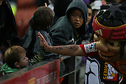 Little Chief with a young fan  during the Investec Super 15 Rugby match, Chiefs v Rebels, at Waikato Stadium, Hamilton, New Zealand, Saturday 5 March 2011. Photo: Dion Mellow/photosport.co.nz