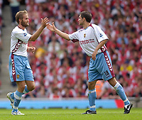 Photo: Daniel Hambury.<br />Arsenal v Aston Villa. The Barclays Premiership. 19/08/2006.<br />Villa's Olof Melberg (L) celebrates his goal with Aaron Hughes.