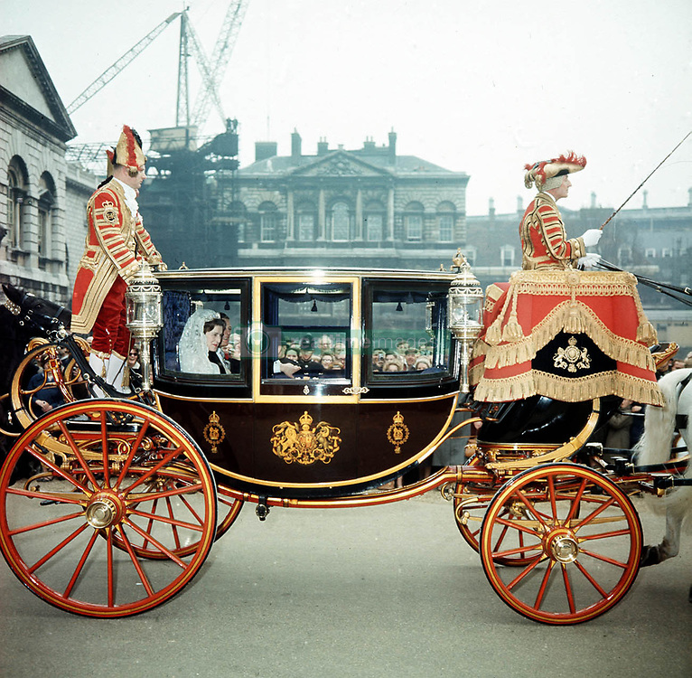 Princess Alexandra (daughter of the Duke and Duchess of Kent) and her husband, Sir Angus Ogilvy, riding in a carriage through London after their wedding at Westminster Abbey.