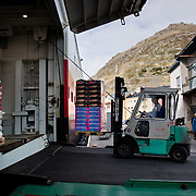 Three weeks aboard the Kong Harald. Hurtigruten, the Coastal Express. Loneporte of the passenger ship being loaded.