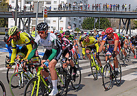 Semi-professional cycle racing, San Pedro de Alcantara, Marbella, Malaga, Province, Spain, March 2015. Spectators watch from the elevated pedestrian walkway along the new Bulevar aka The Boulevard. 201503140589<br />